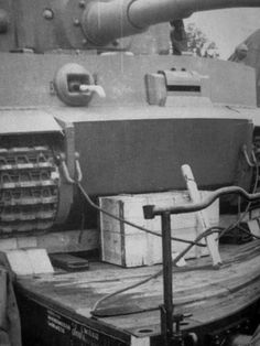 A new Tiger 1 with it's gear  properly secured to a heavy duty flat car for transportation by ordinance train