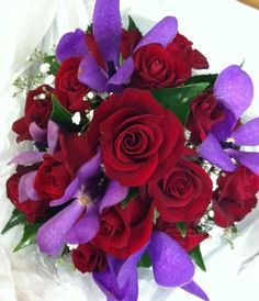 Posy of red roses, purple lisianthus and babies breath-no purple but yellow!!