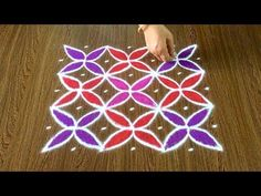 Simple Flower Rangoli Design with Beautiful Colours and Dots Simple Flower Rangoli, Rangoli Designs Flower, Small Rangoli, Rangoli Designs With Dots, Kolam Designs, Simple Flowers, Padi Kolam, Kolam Rangoli, Easy Rangoli