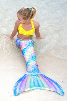 Mermaid Tail for Swimming   by  Fin Fun Sweet Dreams swimmable mermaid tail! This unicorn mermaid tail features seashell-shaped scales and scattered stars. Be a unicorn AND a mermaid!