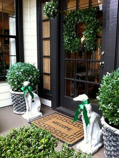 Painting Exterior Doors -- Black Doors,boxwood and naturally dog statues flanking the doors!