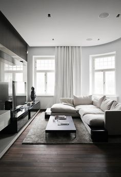 Living Room ~ low coffee table, two piece sectional, area rug, large windows for natural light