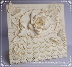 Butterflies and flowers on this gorgeous distressed white on white  card.