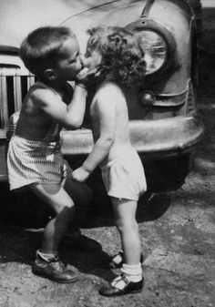First kiss - Funny baby boy is kissing baby girl. Very cute.
