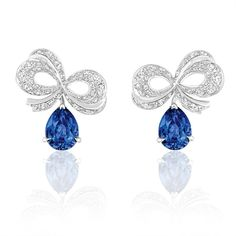 The Dior earrings from the Milieu du Siecle Diamant collection suspend diamond bows and blue sapphires off the ear.