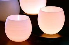 very simple, very beautiful luminaries - water balloons dipped in paraffin wax