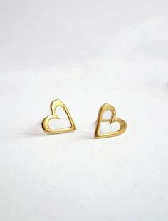 Classic Gold Heart Earrings; these pretty gold heart stud earrings are the perfect earrings for the Holidays! Wear your love with this pretty little pair. Material: 14k Gold Vermeil (Sterling Silver p