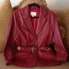 Genuine Lambskin Leather - Blazer  Soft, Wine colored blazer that's 100% Genuine Lambskin Leather, by Worthington. Size medium. Nice fitted waistline for a feminine look. And a single open pleat in the back. Lined with matching color. Three buttons closures. Excellent condition  Worthington Jackets & Coats Blazers