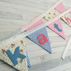This personalised mini bunting is destined for a bed canopy - but doesn't it also look great on its own!