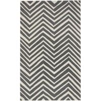 Liven up your child's room with the Skinny Chevron Rug in Charcoal.