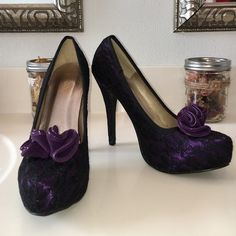 Qupid Heels Flirty low platform.   Purple with black lace and purple bow.   I've never had an outfit to wear these with ☹️.  Like new condition - never worn out. Qupid Shoes Heels