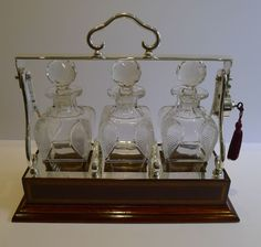 Inlaid Mahogany and Silver Plate Tantalus / Decanter Caddy - Shaped & Cut Bottles
