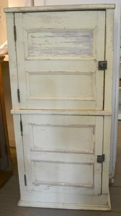 Lay old door on its side and cut doors for cabinets...super-cheap cabinet doors :).