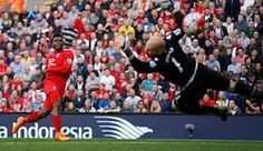 Daniel Sturridge beats Brad Guzan to score his team's second goal.