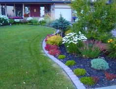 Landscape bricks make for nice clean defined borders between a lawn and garden. They are easy to install and can be set at the right height to mow over.