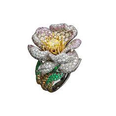 Giampiero Bodino ring with white, grey, yellow, and cognac diamonds, pink sapphires, and emeralds.