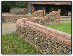 A traditional canted brick and half round coping. Brick Wall Gardens, Brick Garden, Brick Fence, Garden Gates, Driveway Entrance, Entrance Gates, Fence Gates, Fencing, Brick Courtyard