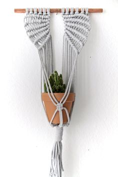 These macrame planters are a new, modern take on plant hangers as we know them. The design has an elegant, yet minimalistic style, suitable for any interior.  A perfect gift for an urban gardener and plant lover!  Materials: Recycled cotton rope, copper rod Available colours: Cream, black, grey Measurements: 35cm x 55cm  This item is an original design of Mo & Mum. Each of the planters slightly differs from one another.  Handmade with♥ by Mo.