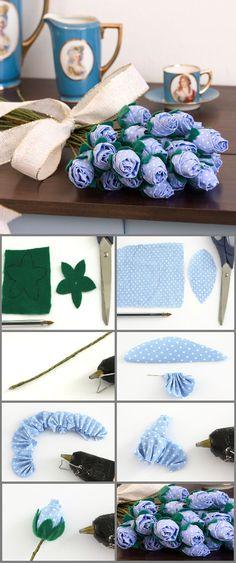 Rosas de fuxico     Materiais utilizados:   • Tesoura  • Cola quente  • Linha invisível   • Agulha   • 60 cm de fita de cetim verde-floresta 10 mm  • 12 x 6 cm de tecido de algodão azul   • Feltro verde 12x6 cm  • 34 cm de arame galvanizado nº 16   • Papel cartão  • Caneta  • Moldes no Material de Apoio em http://www.portaldeartesanato.com.br/materias/750/Rosas+de+fuxico    1 - Com a caneta, transfira o molde de estrela para o feltro. Com a tesoura, recorte no risco.  2 - Agora transfora o…