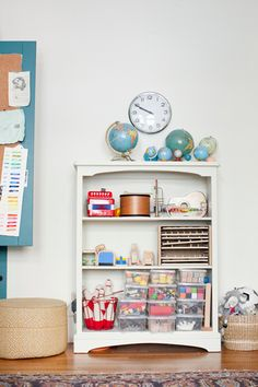 toys are kept on this shelf; they're all visible and ones that don't fit aren't kept (how many toys does one kid *really* need/play with?)