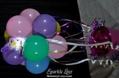 Sparkle Sparkle Sparkle!   Purple Sparkle Lites Butterfly on a white Sparkle Lites base in a balloon topiary tree.   www.sparklelites.com