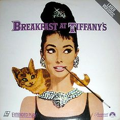 Original Breakfast at Tiffany's  It's original artwork on a laserdisc cover... pretty sure you're not going to use the disc, so just frame the whole thing and use it as wall-art. Instant style. I'm tellin' you, it's way more original than buying a reprint from a poster store.