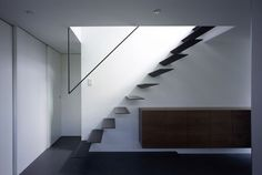 Skim Milk: Ring by APOLLO Architects floating steel stair  on a website devoted entirely to stairs.