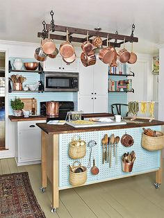 We love the bright and lovely look of this re-done farmhouse kitchen…