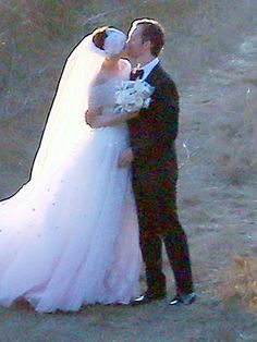 CONGRATS! Actress Anne Hathaway's Wedding Photo. Her Dress: a custom Valentino. She also donned a 1920's inspired head band attached to a simple veil. Thank u People.com