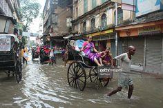 The water luggage's Kolkata Road under heavy rain in India on 25 July 2016.