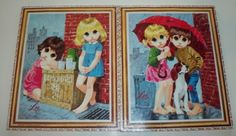 Vintage Lee Art Big Eyed Kids.  Adorable with the lemonade stand and the boy and girl sharing their umbrella with their dog.