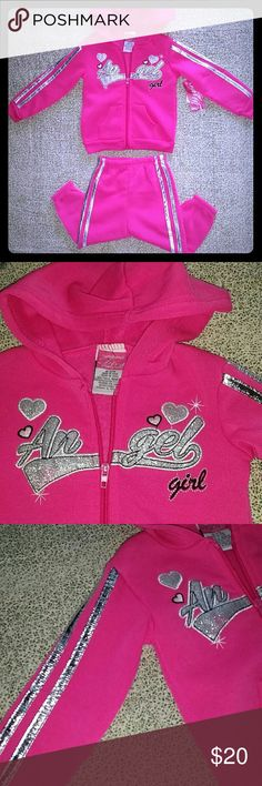 2 pc Diva pink jogging set size 18 mths nwt zipper New with tags 2 piece jogging Suit set by Diva. Pink zipper front with the words Angel Girl on front. Metallic silver stripes on arms and legs. Too cute for Fall. Diva Matching Sets