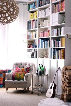 IKEA Billys 10 Ways: The World's Most Versatile Bookcase. i like the idea of a floor to ceiling bookcase made with these IKEA shelves. Doors are a nice way to hide clutter. Ikea Billy Bookcase Hack, Ikea Shelves, Billy Bookcases, Billy Bookcase With Doors, Ceiling Shelves, Tall Shelves, Ikea Storage, Closet Storage, Extra Storage