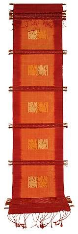 This exquisitely woven fine-silk prayer flag has red borders and a salmon-colored central panel created with ikat-dyed threads. Divided by narrow wooden dowels and decorative multi-stranded wefts of gold, white, and red silk, the textile has five vertical decorated rectangles, each approximately 5 1/2 inches long. | Clothroads