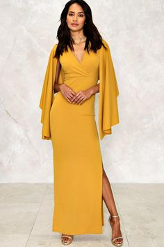 That's a wrap. The search for the perfect statement dress is over now we have the Lexi Cape Style Maxi Dress, a scene-stealing creation featuring a maxi length, V neck, side slit and unique cape design.