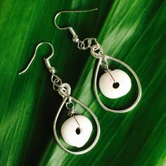 Made a pair of Hawaii Puka Shell silver wire frame dangling earrings!
