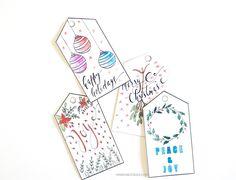 Download free printable Christmas gift tags that you can color by Zakkiya Hamza of Inkstruck Studio.