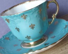 Antique 1930's Aynsley tea cup and saucer set, blue tea cup set, blue and gold fleur de lis tea cup, English tea set, bone china tea cup