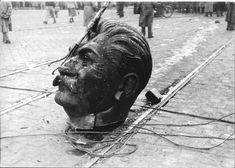 World History in Pictures A disembodied statue of Joseph Stalin's head on the streets of Budapest during the Hungarian Revolution, 1956
