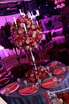 Pretty floral candelabra in pink and purple #wedding #flowers