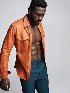 Antonio Brown wearing an orange shirt and blue pants. Orange Jacket, Orange Shirt, Leather Men, Leather Pants, Leather Jackets, Antonio Brown, Brown Fashion, Western Shirts, Blue Pants