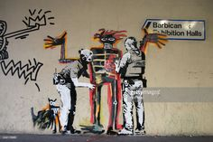 Two artworks by Banksy are pictured at the Barbican centre in central London, on September 18, 2017. The murals, inspired by the upcoming Jean-Michel Basquiat exhibition at the centre, were confirmed as genuine on the artists verified social media account.