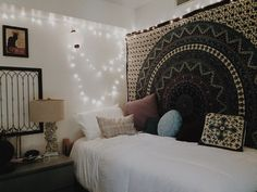 Tapestry textile cloths hanging from wall with accent lights.