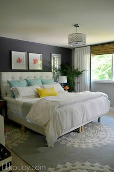 Colorful Coastal Chic Master Bedroom Makeover, love the carpet. Good design for low ceiling.