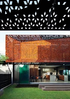Screen House by Steendyk. The extension to this lowset cottage comprises two pavilions that are wrapped in custom-designed, perforated Coreten steel screens.