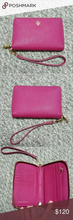 Tory Burch Robinson phone wallet/wristlet Excellent condition. Only used a couple of times before I realized I'd prefer a larger size wallet. Practically new without tag. No signs of wear. Priced to sell. Only reasonable and respectful offers will be considered :) No low-balling please! Feel free to ask any questions! Tory Burch Bags Wallets