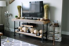 These DIY rustic pumpkins look perfect on this black pipe TV console table!
