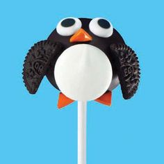 Celebrate winter with these penguin cookie pops, a unique sweet treat.