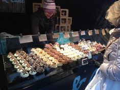 Cup cake market stall - sneeze stand with flavours pinned to top