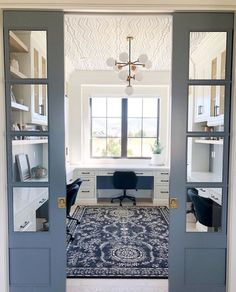 -Blue pocket doors and a wallpapered ceiling! What is there not to love about thi… Blue pocket doors and a wallpapered ceiling! What is there not to love about this homework room! Office Nook, Home Office Space, Home Office Design, Home Office Decor, House Design, Home Decor, Office Ideas, Home Office Furniture Design, Hallway Office